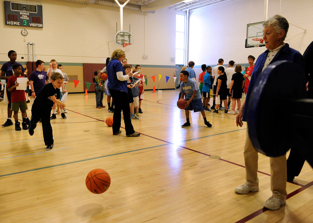 . DENVER, CO. - FEBRUARY 23: The kids line up an take their turn at the passing skill test. The Tamarac Optimist Club sponsors one of the Tri-Star Basketball Competitions at the Eisenhower Recreation Center in Denver. The competitions are held over a several week period for boys and girls 8-13 years-old. The winners from this competition go on to the regional finals, and those winners will play in the final competition on Mar. 23, 2013 at the Pepsi Center before a Nuggets game. There are still several opportunities for kids to try out. Go to www.tristarbasketball.org for upcoming times and locations. (Photo By Kathryn Scott Osler/The Denver Post)