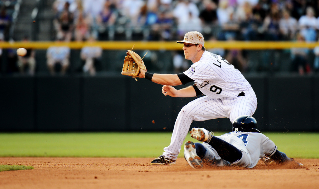 . Denver, CO. - June 08: Cameron Maybin of Diego Padres (24) steals 2nd base from DJ LeMahieu of Colorado Rockies (9) in the 4th inning of the game at Coors Field. Denver, Colorado. June 8, 2013.  (Photo By Hyoung Chang/The Denver Post)