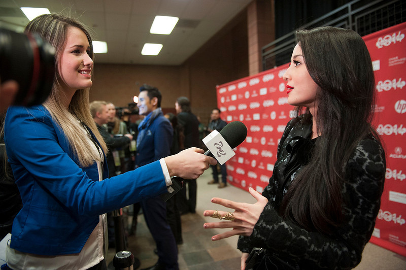 """. Actress Julie Estelle is interviewed at the premiere of the film \""""The Raid 2\"""" during the 2014 Sundance Film Festival, on Tuesday, Jan. 21, 2014, in Park City, Utah. (Photo by Arthur Mola/Invision/AP)"""