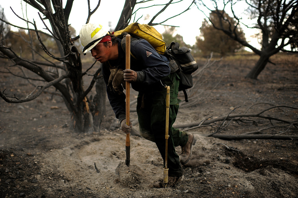 . Tim Bigman and 19 firefighters from Bighorn 209, a hand crew from Montana, check for hot spots by Cedar Heights  Road in Colorado Springs, Colo., Friday, June 29, 2012. Hyoung Chang, The Denver Post