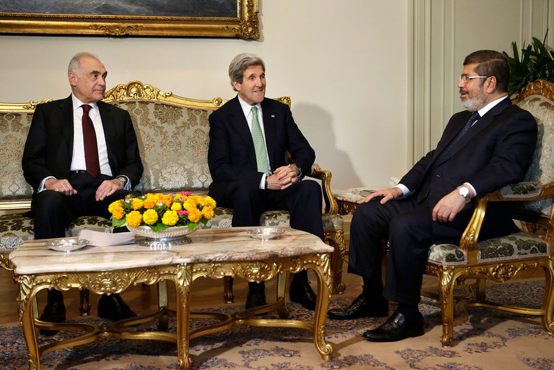 . Egyptian Foreign Minister Kamel Amr, left, sits with U.S. Secretary of State John Kerry, center, and Egyptian President Mohamed Morsi during their meeting at the Presidential Palace in Cairo, Egypt on Sunday, March 3, 2013. Kerry met with Egypt\'s president Sunday, wrapping up a visit to the deeply divided country with an appeal for unity and reform. The U.S. is deeply concerned that continued instability in Egypt will have broader consequences in a region already rocked by unrest. (AP Photo/Jacquelyn Martin)