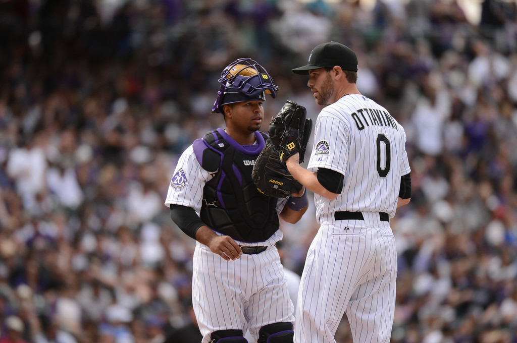 . Wilin Rosario (20) of the Colorado Rockies goes to the mound to talk with Adam Ottavino (0) of the Colorado Rockies in the seventh inning. (Photo by Hyoung Chang/The Denver Post)