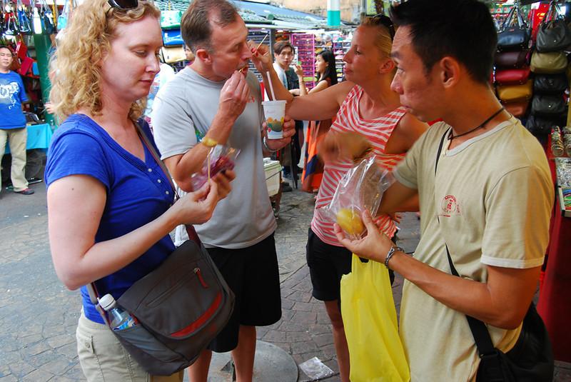 sampling street food in Kuala Lumpur.jpg