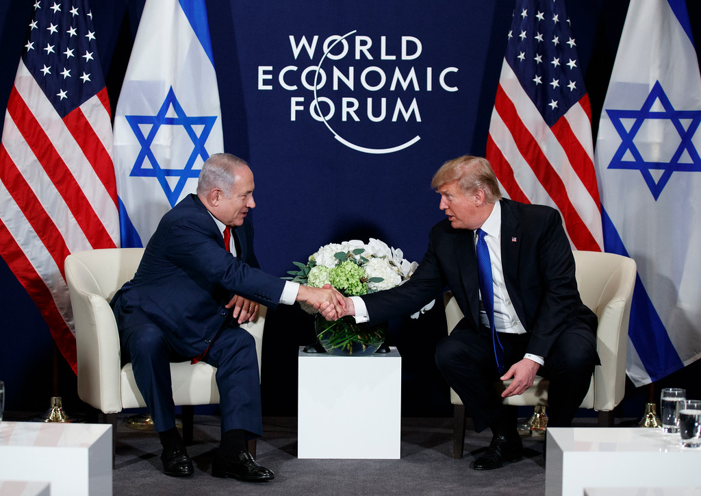 . President Donald Trump shakes hands with Israeli Prime Minister Benjamin Netanyahu during a meeting at the World Economic Forum, Thursday, Jan. 25, 2018, in Davos. (AP Photo/Evan Vucci)