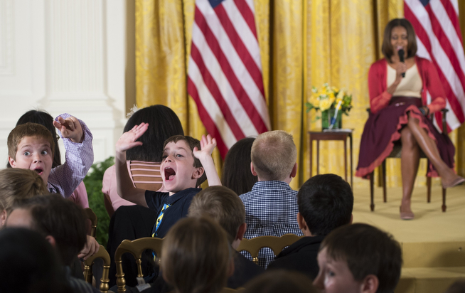 . Children make faces for the television cameras as US First Lady Michelle Obama speaks with children of Executive Office employees at the White Houses annual Take Our Daughters and Sons to Work Day in the East Room of the White House in Washington, DC, April 24, 2014. (SAUL LOEB/AFP/Getty Images)