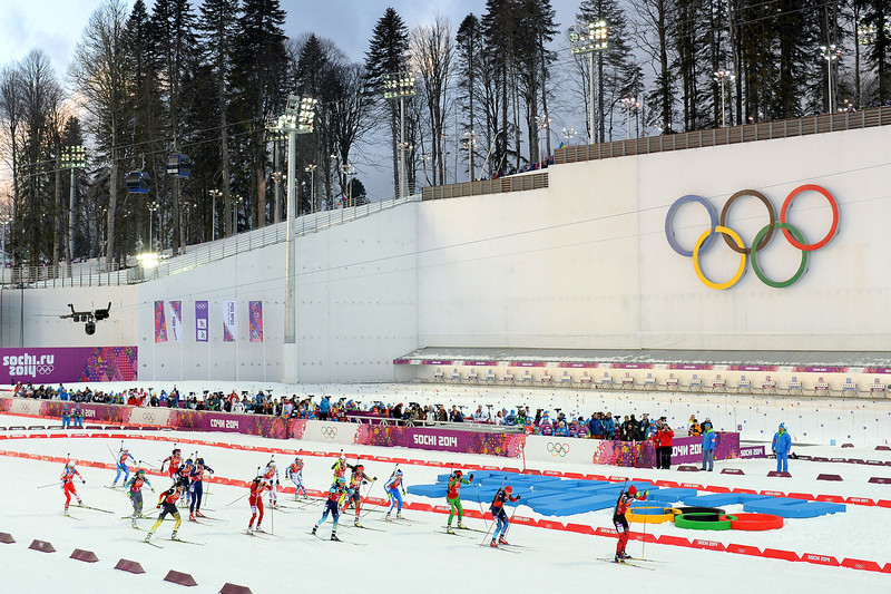 . Athletes pass the Olympic Rings as they start the Women\'s 4 x 6 km Relay during day 14 of the Sochi 2014 Winter Olympics at Laura Cross-country Ski & Biathlon Center on February 21, 2014 in Sochi, Russia.  (Photo by Harry How/Getty Images)