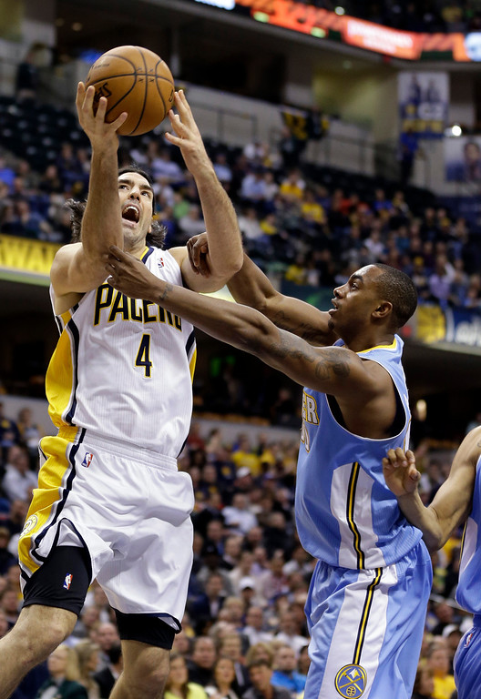 . Indiana Pacers guard George Hill (4) is fouled by Denver Nuggets forward Darrell Arthur in the second half of an NBA basketball game in Indianapolis, Monday, Feb. 10, 2014. The Pacers defeated the Nuggets 119-80.  (AP Photo/Michael Conroy)