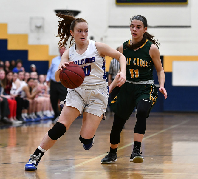 2/26/2020 Mike Orazzi | Staff St. Paul Catholic High School's Sophia Gerst  (10) and Holy Cross' Mya Zaccagnini (11) during Wednesday night's CCC girls basketball tournament at Kennedy High School in Waterbury.