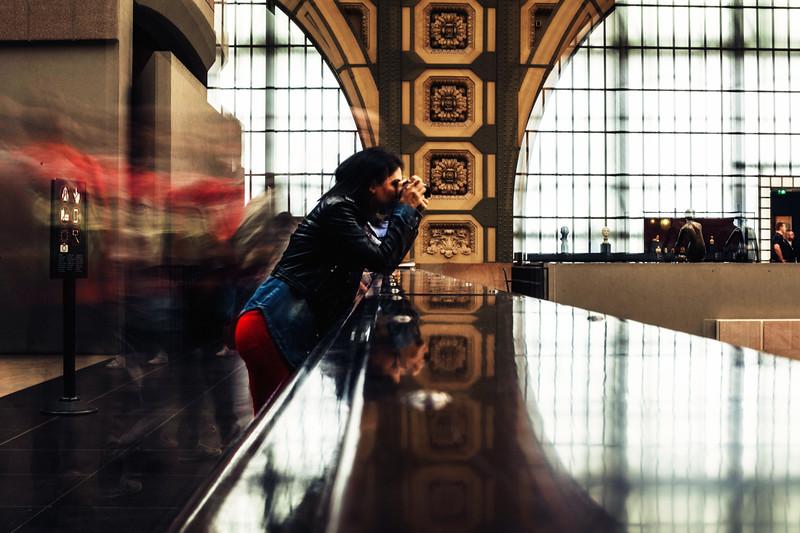 louvre blur woman shooting cmera paris.jpg
