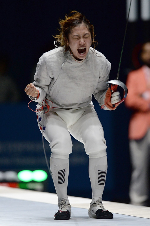 . South Korea\'s Kim Jiyeon reacts after beating China\'s Shen Chen during the women\'s sabre team fencing finals at Goyang gymnasium during the 2014 Asian Games in Incheon on September 23, 2014. PRAKASH SINGH/AFP/Getty Images