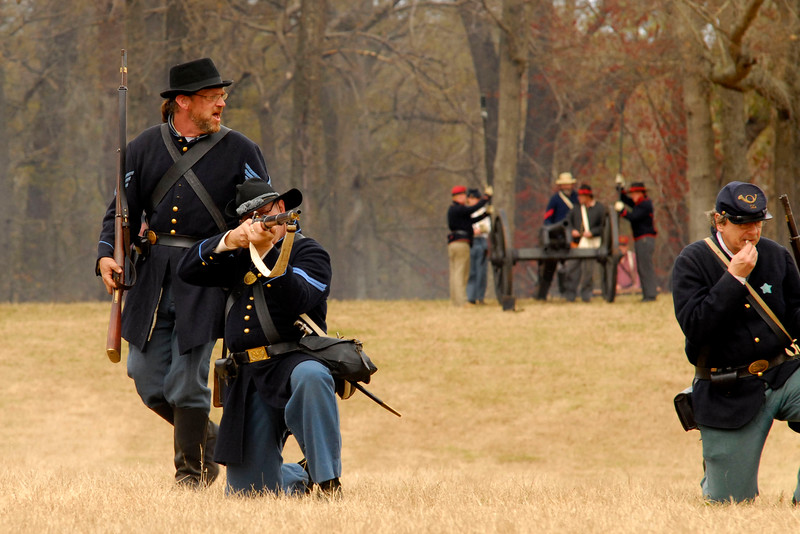 A Union infantry reenactor gives orders while another prepares to fire down the battlefield. The Skirmish at Gamble's Hotel happened on March 5, 1885 when 500 federal soldiers, under the command of Reuben Williams of the 12th Indiana Infantry, marched into Florence to destroy the railroad depot but were met by Confederate soldiers backed up with 400 militia. The reenactment, held by the 23rd South Carolina Infantry, was held at the Rankin Plantation in Florence, South Carolina on Saturday, March 5, 2011. Photo Copyright 2011 Jason Barnette