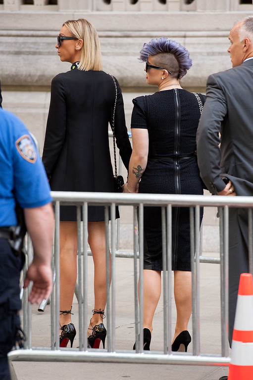. Giuliana Rancic (L) and Kelly Osbourne attend the Joan Rivers memorial service at Temple Emanu-El on September 7, 2014 in New York City. Rivers passed away on September 4, 2014 after suffering respiratory and cardiac arrest during vocal cord surgery on August 28, 2014.  (Photo by D Dipasupil/Getty Images)
