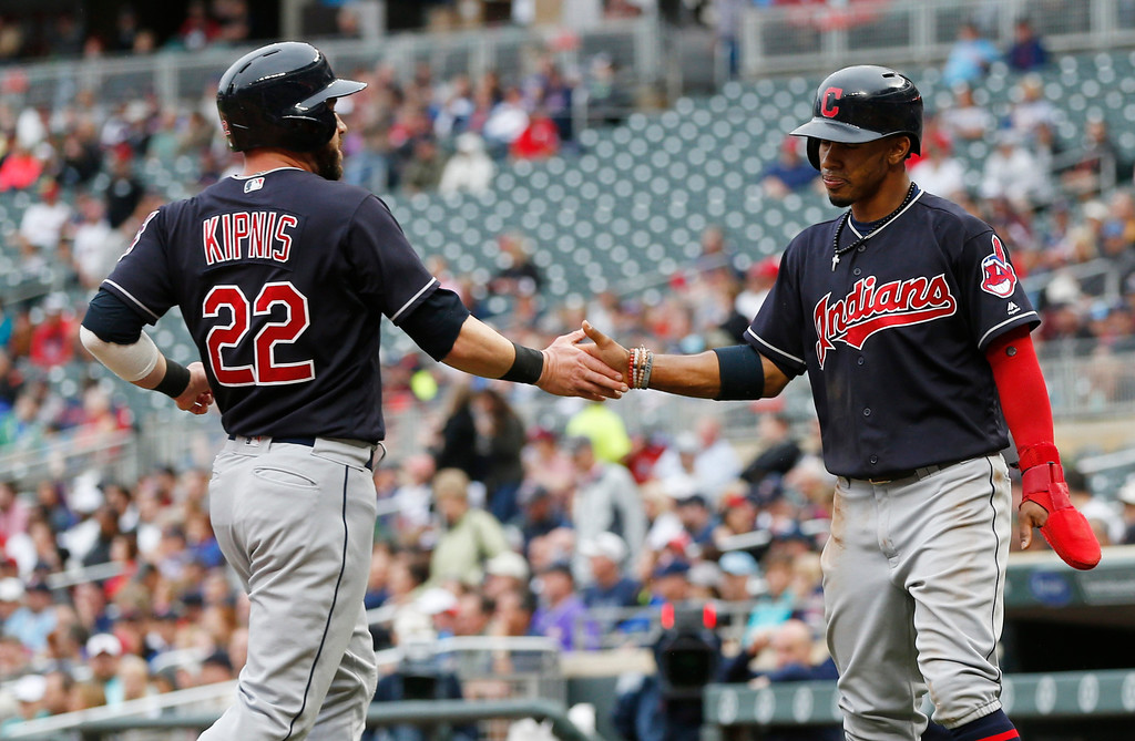 . Cleveland Indians\' Jason Kipnis, left, and Francisco Lindor celebrate as they score on a Jay Bruce single off Minnesota Twins pitcher Kyle Gibson in the first inning of the first game of a baseball doubleheader Thursday, Aug. 17, 2017, in Minneapolis. (AP Photo/Jim Mone)