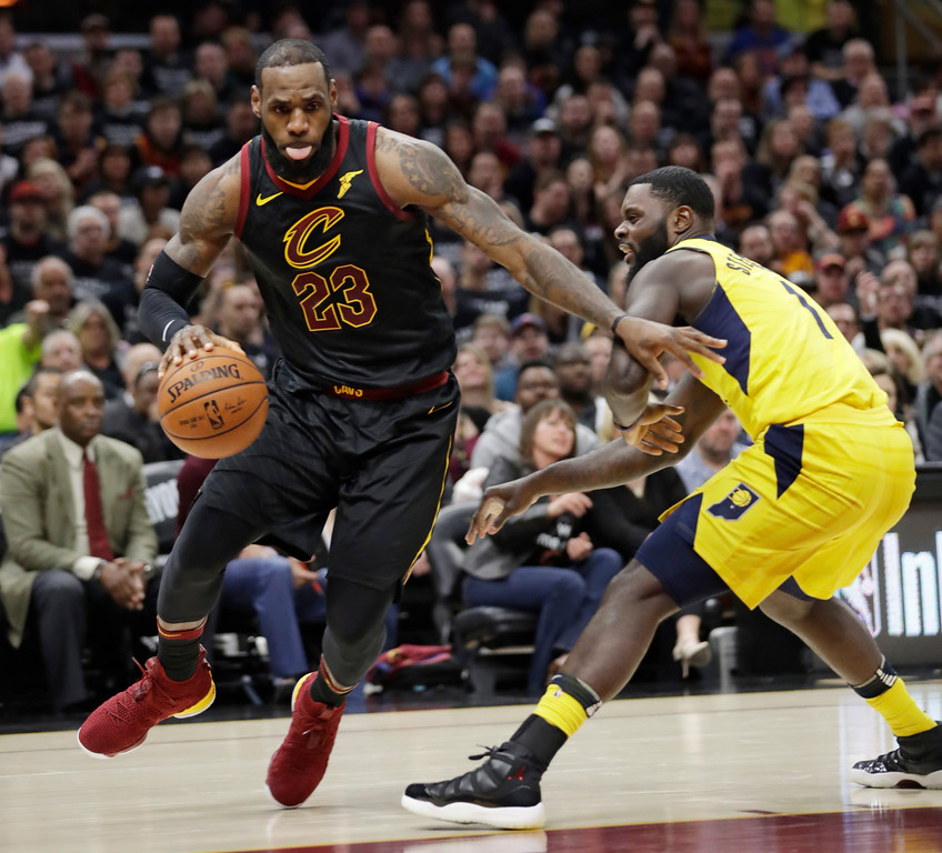 . Cleveland Cavaliers\' LeBron James, left, drives past Indiana Pacers\' Lance Stephenson in the first half of Game 7 of an NBA basketball first-round playoff series, Sunday, April 29, 2018, in Cleveland. (AP Photo/Tony Dejak)