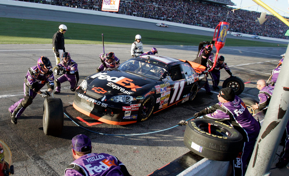 Description of . NASCAR driver Denny Hamlin gets service during the Daytona 500 at Daytona International Speedway in Daytona Beach, Fla., Sunday, Feb. 18, 2007. (AP Photo/Reinhold Matay)