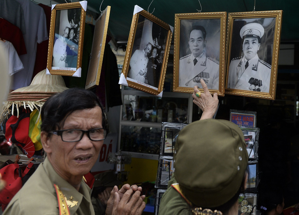 . Veterans buy a framed portrait of the late General Vo Nguyen Giap at a tourist shop inside the Army Museum in Hanoi on October 10, 2013. The death of Vietnam\'s last great independence leader has sparked a battle over his legacy, with the regime seeking a girm grip on his image as communist hero, and brushing aside his criticism of the party in later life. HOANG DINH NAM/AFP/Getty Images