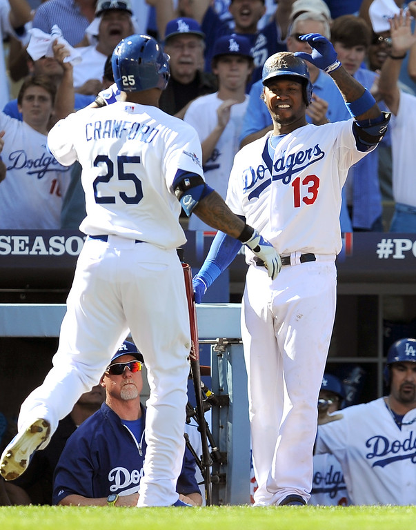 . The Dodgers\' Hanley Ramirez congratulates Carl Crawford after Crawford\'s homerun against the Cardinals during game 5 of the NLCS at Dodger Stadium Wednesday, October 16, 2013.(Hans Gutknecht/Los Angeles Daily News)