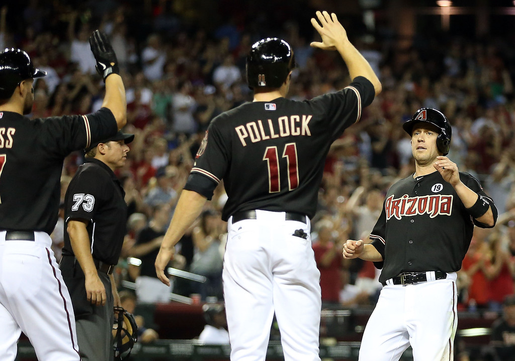 . PHOENIX, AZ - JULY 10:  Aaron Hill #2 of the Arizona Diamondbacks high fives A.J. Pollock #11 after scoring against the Los Angeles Dodgers during the fifth inning of the MLB game at Chase Field on July 10, 2013 in Phoenix, Arizona.  (Photo by Christian Petersen/Getty Images)