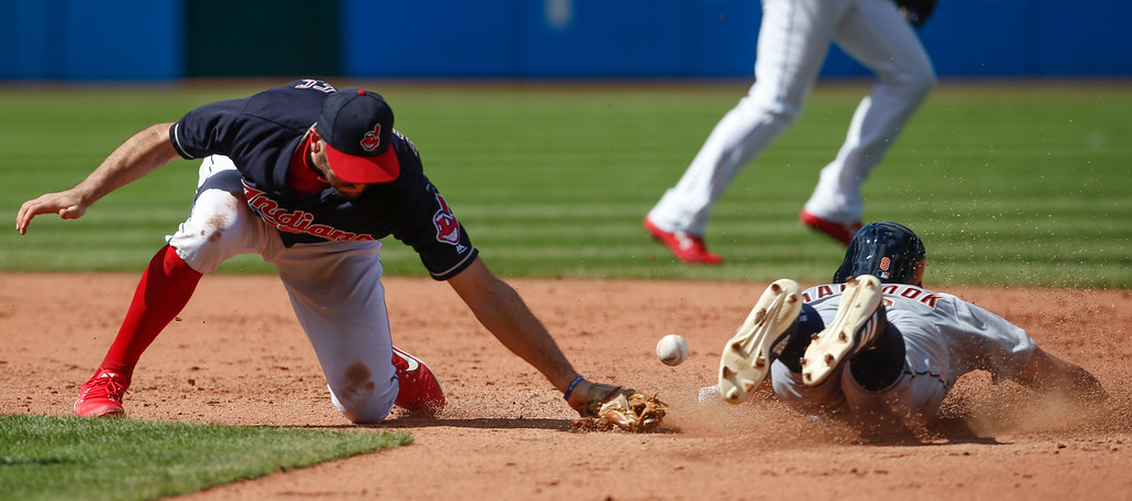 . Detroit Tigers\' Mikie Mahtook steals second base as the ball gets away from Cleveland Indians\' Adam Rosales during the fifth inning of a baseball game, Sunday, Sept. 16, 2018, in Cleveland. (AP Photo/Ron Schwane)