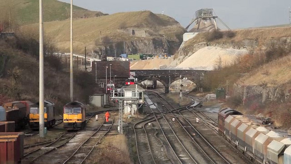 """Class 60 getting under way from Peak Dale with a loaded stone train. The """"shunter shed"""" is following the train down to the signal box to move back into the plant."""