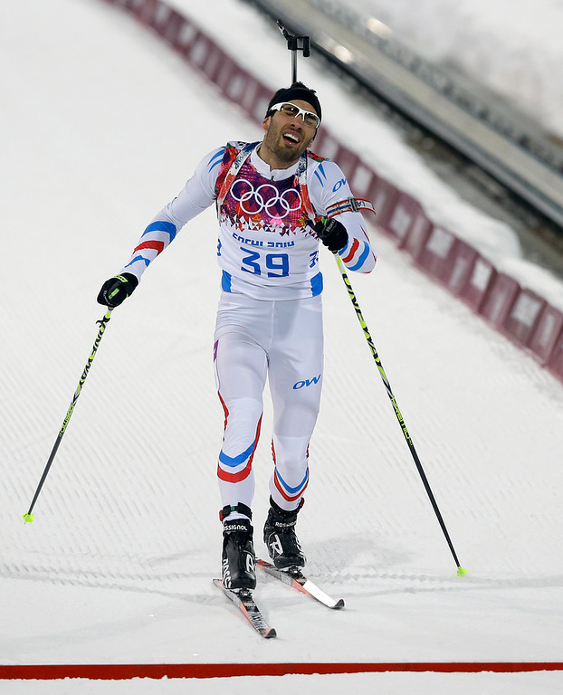 . France\'s Martin Fourcade crosses the finish line during the men\'s biathlon 10k sprint, at the 2014 Winter Olympics, Saturday, Feb. 8, 2014, in Krasnaya Polyana, Russia. (AP Photo/Kirsty Wigglesworth)