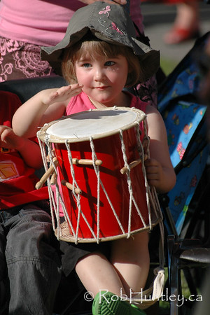 Young drummer participating in the Westfest Tam Tam session with D. Lee. Westfest is an annual event in the community of Westboro in Ottawa, Ontario.  © Rob Huntley