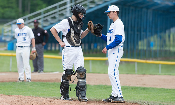 05/29/19 Wesley Bunnell | Staff Southington defeated New Britain 4-3 in 11 innings on a walk off single by Billy Carr (17) in the continuation of a game suspended in the 10th inning due to rain on May 29th. Catcher Jacob Delmonte (2) and pitcher Vincent Spizzoucco (19).