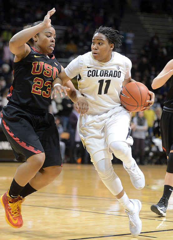 . Colorado\'s Brittany Wilson drives against Southern California\'s Brianna Barrett during the first half of an NCAA college basketball game on Sunday, March 2, 2014, in Boulder, Colo. (AP Photo/Daily Camera, Cliff Grassmick) NO SALES