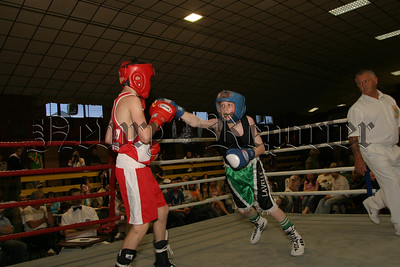Barry Lavelle (dark jersey) St Malachys Camlough, lands a good punch on his opponent. 06W27S20