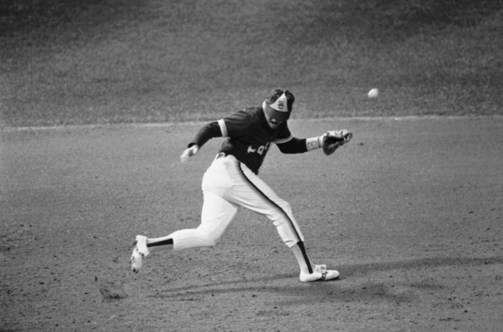 . A hit by Detroits Larry Herndon goes through San Diego third baseman Graig Nettles in the fourth inning in the World Series at Tiger Stadium, Friday, Oct. 12, 1984, Detroit, Mich. (AP Photo/Lenny Ignelzi)