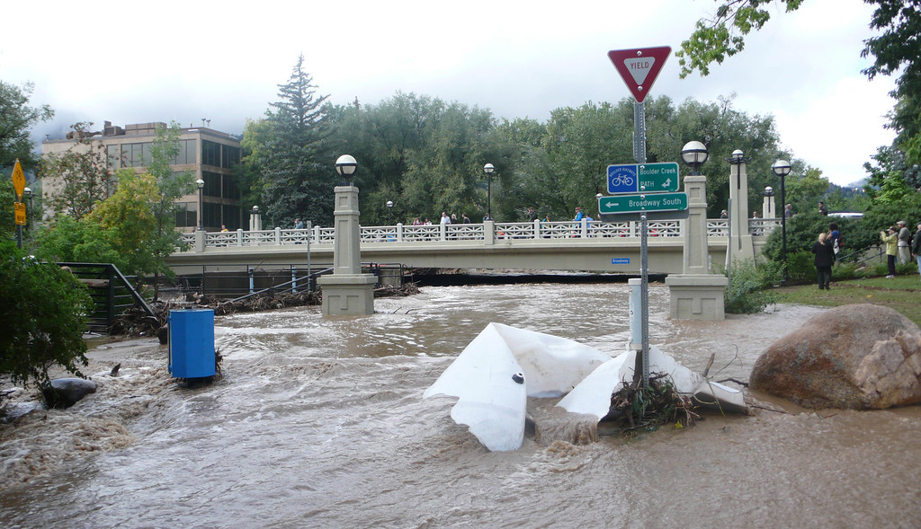 . Boulder Creek, flowing under the Broadway Bridge in downtown Boulder, after reaching a 5,370 cfps high on Thursday night is subsiding on Friday morning, September 13. By 6pm Thursday Boulder had received 9.08 inches. (Photo by David Bjorkman-EPF)