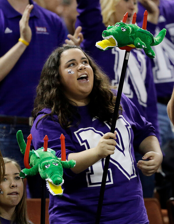 . Northwestern State fans cheer for their team during the first half of a second-round game against Florida in the NCAA men\'s college basketball tournament Friday, March 22, 2013, in Austin, Texas. (AP Photo/David J. Phillip)