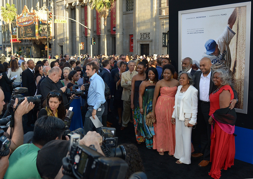 . Rachel Robinson (in white), the widow of baseball legend Jackie Robinson, and her family attend the Los Angeles Premiere of Warner Bros. Pictures\' and Legendary Pictures\' \'42\' at TCL Chinese Theatre on April 9, 2013 in Hollywood, California.  (JOE KLAMAR/AFP/Getty Images)