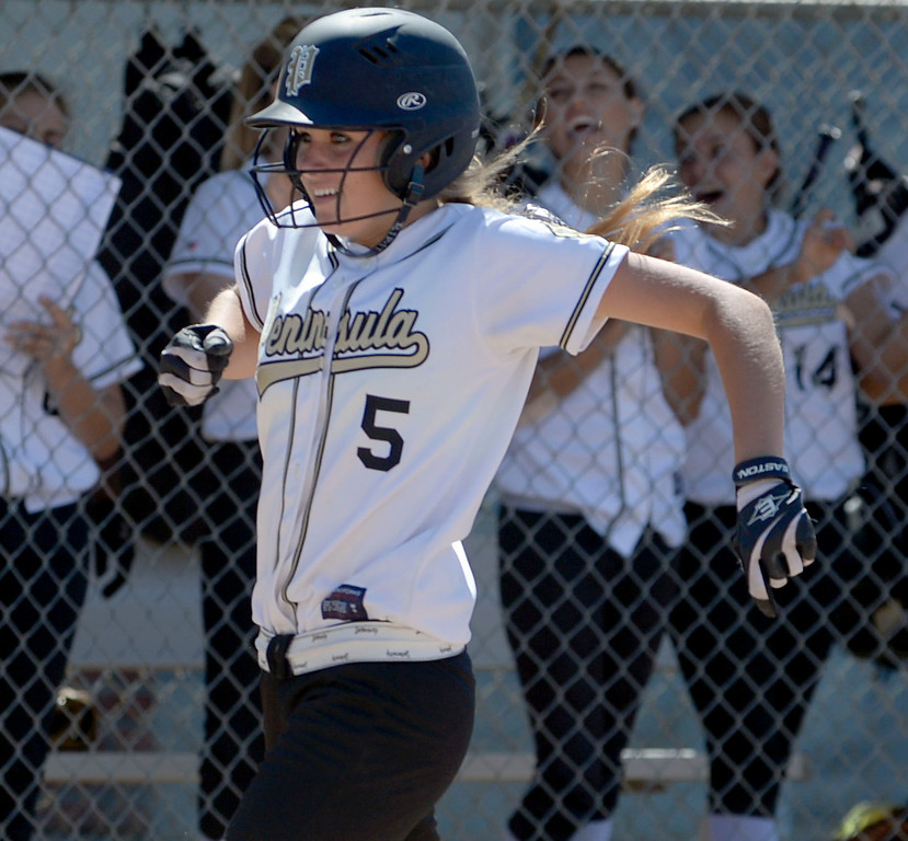 . Home Run - Peninsula\'s Brooke Christensen (5) crosses home after hitting a home run in the first inning against Arroyo Grande in a CIF Southern Section Division III wild-card softball game in Rolling Hills Estates Tuesday. Peninsula won the game 13-0. 20130514 Photo by Steve McCrank / Staff Photographer