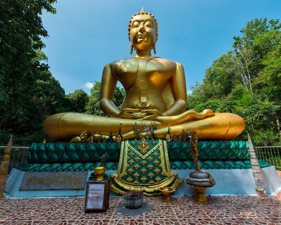 Large Buddha guarding Phang Din, the Naga cave at Nong Khai, Thailand