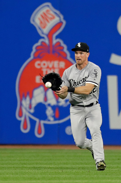 . Chicago White Sox\'s Charlie Tilson fields a single hit by Cleveland Indians\' Michael Brantley in the sixth inning of a baseball game, Monday, June 18, 2018, in Cleveland. (AP Photo/Tony Dejak)