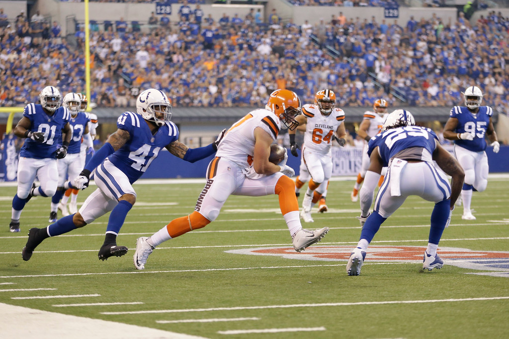 . Cleveland Browns tight end Seth DeValve (87) cuts between Indianapolis Colts strong safety Matthias Farley (41) and Indianapolis Colts free safety Malik Hooker (29) during the first half of an NFL football game in Indianapolis, Sunday, Sept. 24, 2017. (AP Photo/AJ Mast)