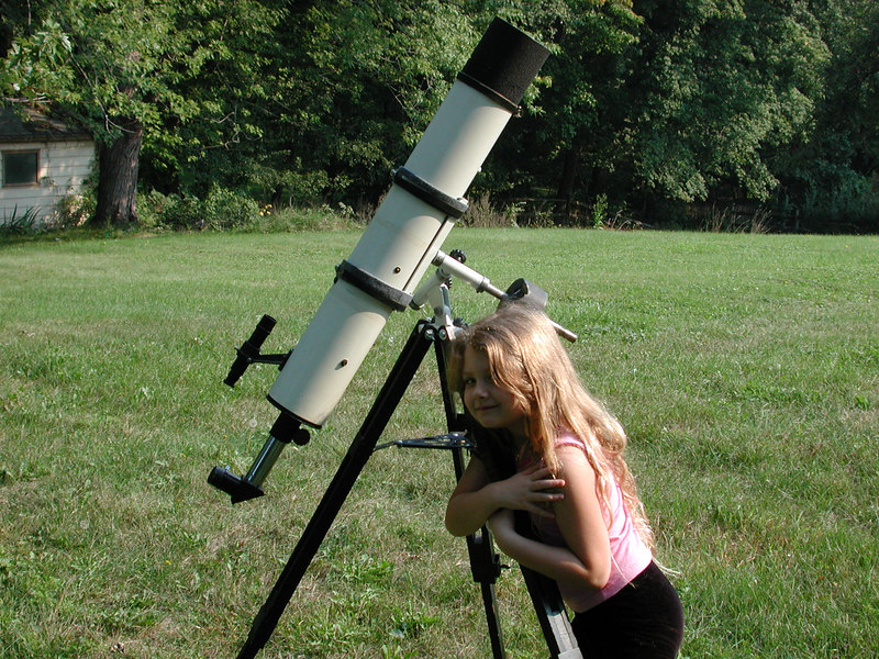 In this image my 5 year old daughter Stormie hugs the telescope.