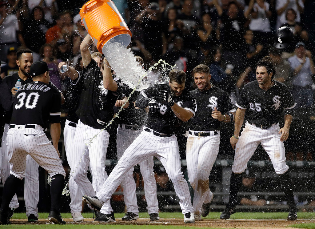 . Chicago White Sox\'s Daniel Palka (18) celebrates with teammates after hitting a home run against the Cleveland Indians during the ninth inning of a baseball game Friday, Aug. 10, 2018, in Chicago. The White Sox won 1-0. (AP Photo/Nam Y. Huh)