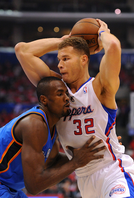 . The Clippers\' Blake Griffin tries to drive against the Thunder\'s Serge Ibaka, Friday, May 9, 2014, at Staples Center. (Photo by Michael Owen Baker/Los Angeles Daily News)