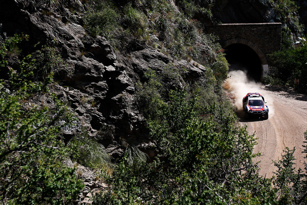 . TANINGA, ARGENTINA - JANUARY 05:  #302 Stephane Peterhansel and Jean-Paul Cottret of France for Team Peugeot Total in the Buggy 2008 DKR Peugeot compete during day 2 of the Dakar Rallly on January 2, 2015 between Villa Carlos Paz and San Juan near the town of Taninga, Argentina.  (Photo by Dean Mouhtaropoulos/Getty Images)