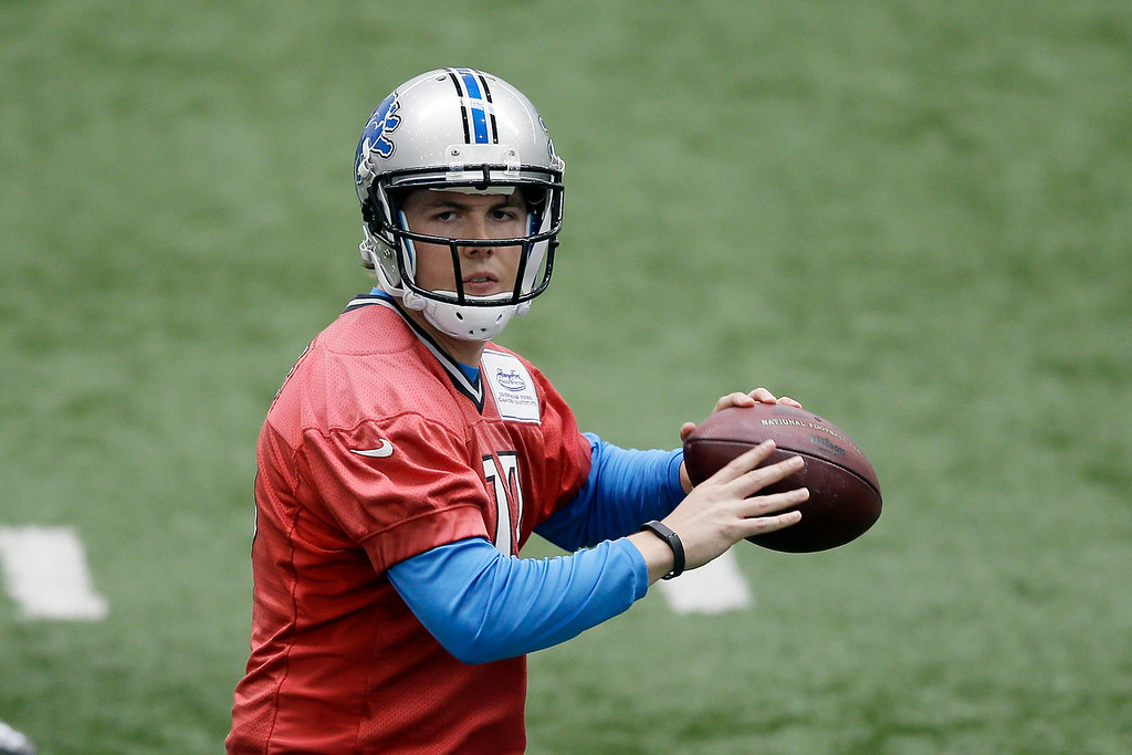 . Detroit Lions quarterback Kellen Moore passes during the team\'s OTA drills at the Lions training camp facility in Allen Park, Mich., Wednesday, May 21, 2014. (AP Photo/Carlos Osorio)