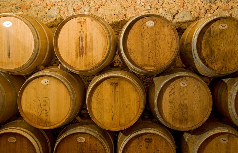 Oak Barrels at Wine Cellar, Chianti, Italy