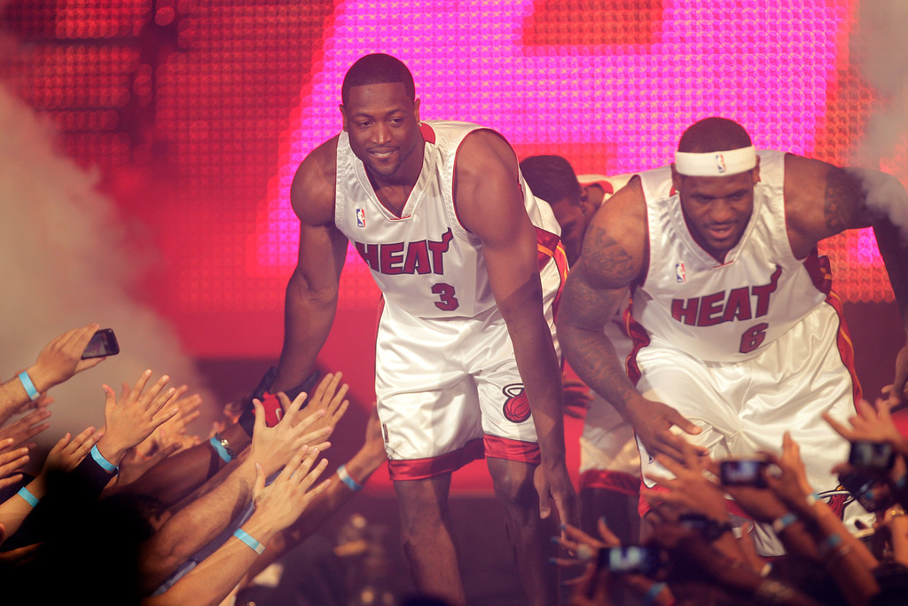 . LeBron James (6) and Dwyane Wade (3) appear at Fan Fest Friday, July 9, 2010 in Miami.  (AP Photo/J Pat Carter)