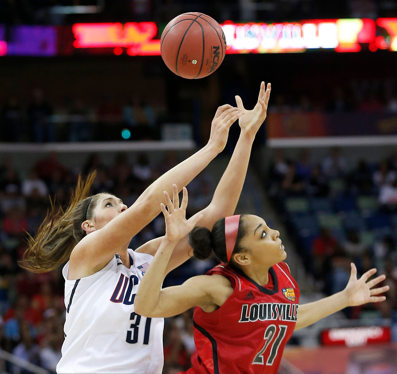 . Connecticut center Stefanie Dolson (31) and Louisville guard Bria Smith (21) battle for a loose ball during first half of the national championship game of the women\'s Final Four of the NCAA college basketball tournament, Tuesday, April 9, 2013, in New Orleans. (AP Photo/Dave Martin)