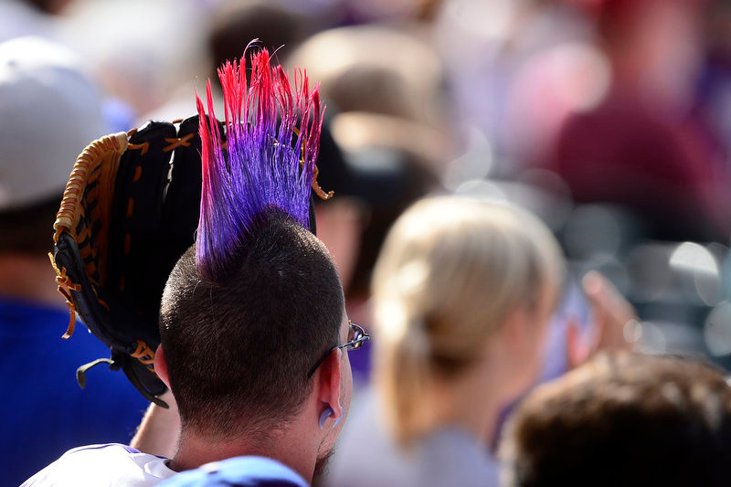 . A fan wears a mohawks while taking in the action between the Los Angeles Dodgers and the Colorado Rockies during the Dodgers\' 10-8 win in Denver on Monday, September 2, 2013. The Colorado Rockies hosted the Los Angeles Dodgers at Coors Field. (Photo by AAron Ontiveroz/The Denver Post)