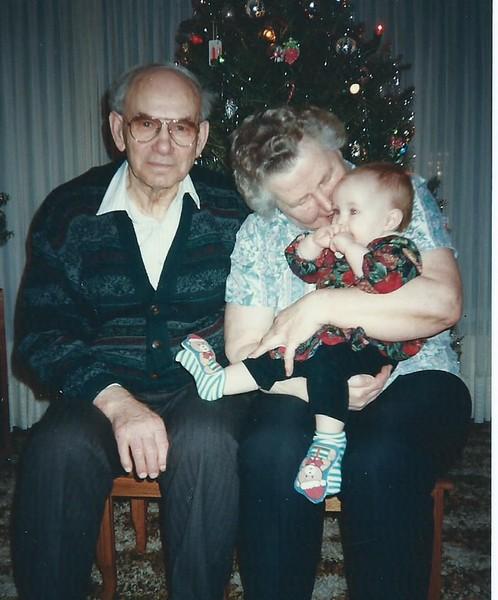 Mom and Dad with Antonia Christmas 1996.jpg