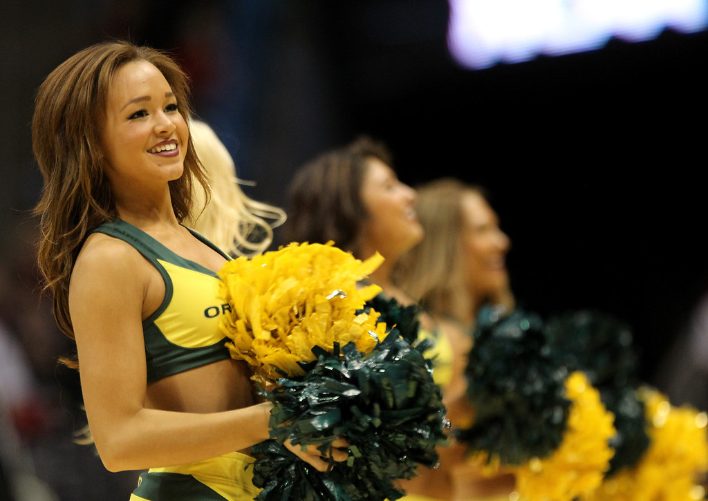 . Oregon Ducks cheerleaders perform during the second round game of the NCAA Basketball Tournament against the Brigham Young Cougars at BMO Harris Bradley Center on March 20, 2014 in Milwaukee, Wisconsin.  (Photo by Mike McGinnis/Getty Images)