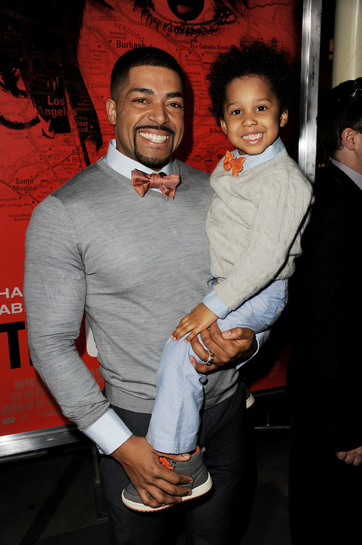 ". Actor/wrestler David Otunga (L) and his son David Otunga, Jr. arrive at the premiere of Tri Star Pictures\' ""The Call\"" at the Arclight Theatre on March 5, 2013 in Los Angeles, California.  (Photo by Kevin Winter/Getty Images)"