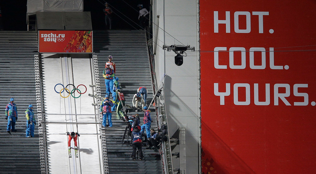 . United States\' Peter Frenette starts an attempt during the ski jumping large hill team competition at the 2014 Winter Olympics, Monday, Feb. 17, 2014, in Krasnaya Polyana, Russia. (AP Photo/Matthias Schrader)